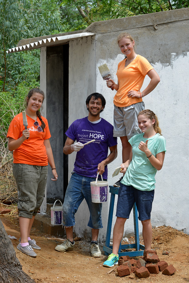 Volunteers from Utah working on a toilet. <br /> Rising Star Outreach of India, Kancheepuram District, Tamil Nadu, India