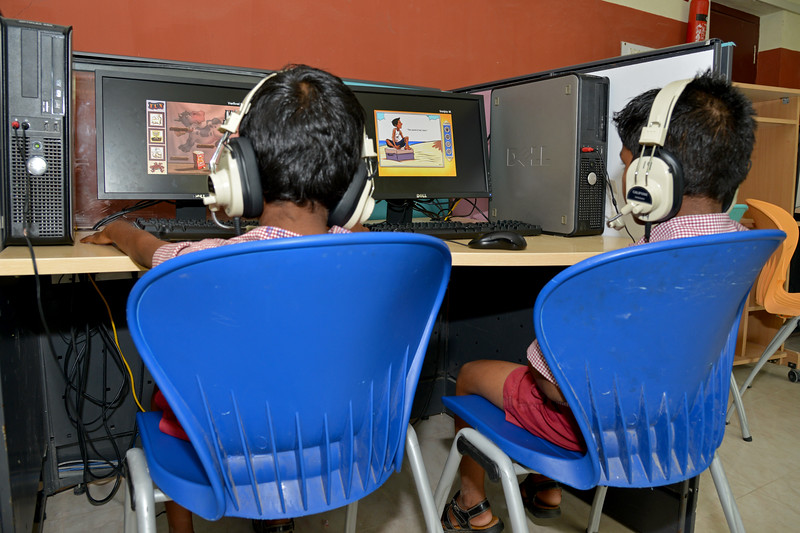 Children working on computers in the computer lab.<br /> Rising Star Outreach of India, Kancheepuram District, Tamil Nadu, India
