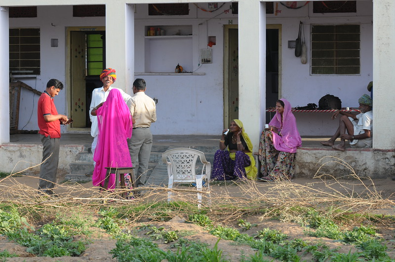 Mobile phone use in Rural Rajasthan (Village near Pushkar): Sayar Singh with visitors to his home at Chamunda Matha Road, Pushkar, Rajasthan, India.