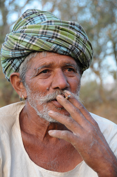 Mobile phone use in Rural Rajasthan (Village near Pushkar): Sayar Singh's father, Chamunda Matha Road, Pushkar, Rajasthan, India.