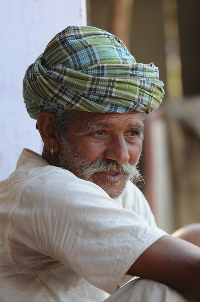 Mobile phone use in Rural Rajasthan (Village near Pushkar): Father of Sayar Singh, Chamunda Matha Road, Pushkar, Rajasthan, India.