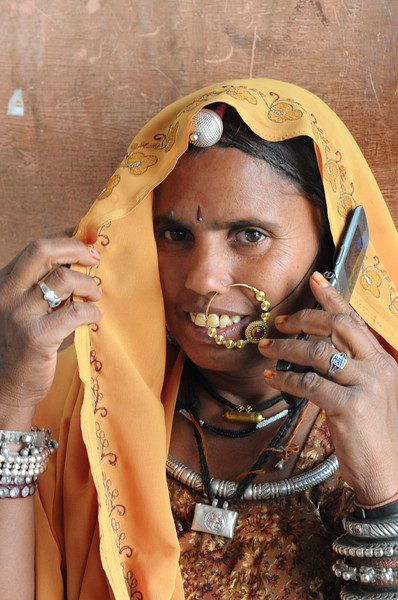 Mobile phone use in Pushkar: Cellphone used in Pushkar, Rajasthan, India.