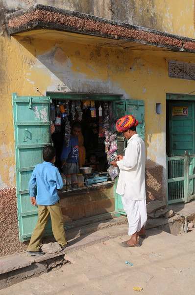 Mobile phone use in Rural Rajasthan (Village near Pushkar): Sayar Singh, who lives in a village near Pushkar, Rajasthan, India getting a refill to his mobile phone from a rural shop.