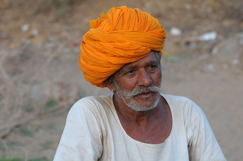 Mobile phone use in Rural Rajasthan (Village near Pushkar): Sayar Singh, Chamunda Matha Road, Pushkar, Rajasthan, India.