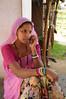 Mobile phone use in Rural Rajasthan (Village near Pushkar): Sister of Sayar Singh using the mobile phone.<br /> Sayar Singh, Chamunda Matha Road, Pushkar, Rajasthan, India.