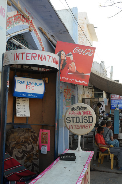 Mobile phone use in Pushkar: STD/ISD/PCO shop that also sells refills for mobile phones in Pushkar, Rajasthan, India.