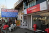Mobile phone use in Pushkar: Vodafone shop right next to the  STD/ISD/PCO shop that also sells refills for mobile phones in Pushkar, Rajasthan, India.