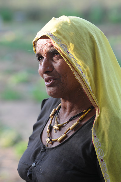 Mobile phone use in Rural Rajasthan (Village near Pushkar): Portrait of Sayar Singh's mother, Chamunda Matha Road, Pushkar, Rajasthan, India.