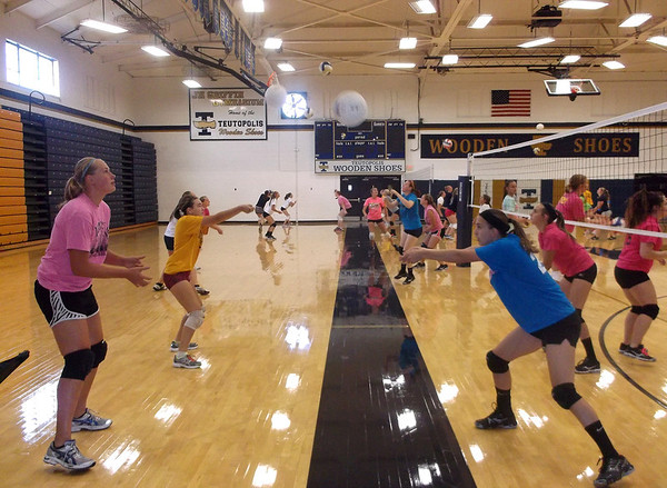 J.H. Griffin Gymnasium at Teutopolis High School was full of action as the first day of volleyball practice kicked off Wednesday afternoon. In the foreground, left, freshman Christy Hoene and junior Michelle Schmidt practiced together.