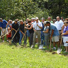 Members of the TREC Board, Effingham city officials, Effingham County officials and volunteers break ground on the third phase of the TREC trails project.