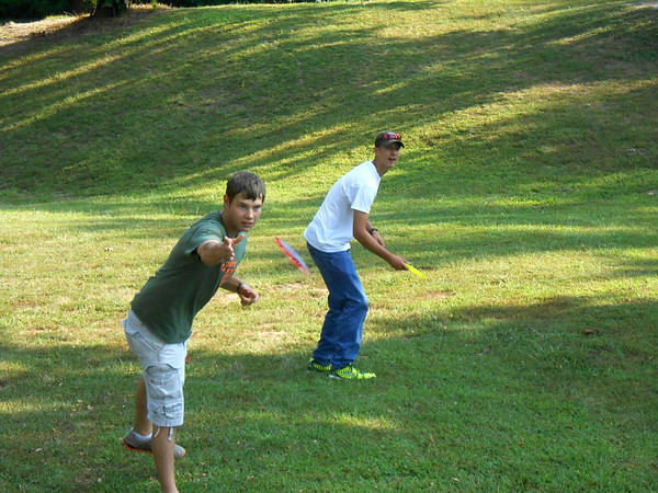 Effingham High School seniors Jordan Stock, left, and Randy Clough play disc golf in Community Park. Clough and Stock have been playing once a week since the beginning of summer.