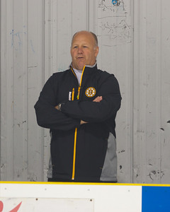 102812, Haverhill, MA - Boston Bruins Coach Claude Julien observes the the Winthrop Squirt B youth hockey team - rebranded as mini Bruins -as he coaches them during a game on Sunday. Herald photo by Ryan Hutton