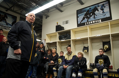 102812, Haverhill, MA - Boston Bruins Coach Claude Julien gives a pep talk to the Winthrop Squirt B youth hockey team - rebranded as mini Bruins - before coaching them during a game on Sunday. Herald photo by Ryan Hutton