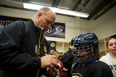 102812, Haverhill, MA - Boston Bruins Coach Claude Julien signs autographs for the Winthrop Squirt B youth hockey team - rebranded as mini Bruins - before coaching them during a game on Sunday. Herald photo by Ryan Hutton