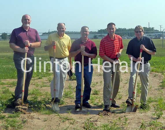 City officials break ground on the $3 million well at 16th Avenue and 11th Street in Fulton, Ill., on July 2. City Administrator Randy Balk, Mayor Larry Russell, Public Works Director Dan Clark, Matt Hansen from Willett Hofmann and Bill Brown of Brown Construction, contractor for the well, are shown at the site of the massive project. • Natalie Conrad/Clinton Herald