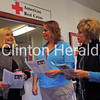 (From left) Community State Bank Fulton branch manager Patti Housenga; Executive Director of the Gateway Area Chapter of the American Red Cross Amber Wood; and BeautiControl independent consultant Carissa Evans talk Thursday at the local Red Cross office about ways they can help with disaster relief on the East Coast. - Katie Dahlstrom/Clinton Herald