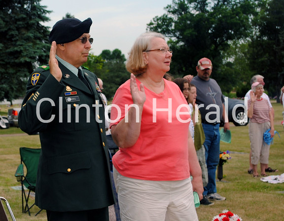 Phil and Julie Harris take a vow to sacrifice for their country during the Clinton Memorial Day Ceremony on May 28. • Katie Dahlstrom/Clinton Herald