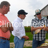 Clinton County Farmer Dustin Johnson (right) shows U.S. Rep. Dave Loebsack, D-Iowa, and fellow farmer Stan Harmsen what effects the drought have had on his crops Thursday on Johnson's farm. • Katie Dahlstrom/Clinton Herald