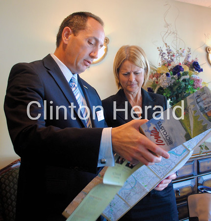 Iowa DOT Director Paul Trombino and Illinois Secretary of Transportation Ann Schneider look at a map of Iowa after the roundtable discussion on Tuesday at Rastrelli's Restaurant in Clinton. • Katie Dahlstrom/Clinton Herald