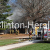 Area firefighters work Thursday to put out a fire that engulfed a home at 17166 Diamond Road, in rural Fulton, Ill. - Samantha Pidde/Clinton Herald