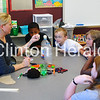 Third-grade teacher Jessie Schneeberger does a science experiment with rising third-grade students Jaedyn Wright, Zander Edwards, Joshlyn Thompson, Olivia Martin and Megan Schwartz during summer enrichment at Jefferson Elementary on June 20. • Katie Dahlstrom/Clinton Herald