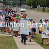 More than 300 people walked up the bike path on the dike on June 10 for the first Clinton-based 1,000 Mile Journey walk to end child abuse. • Samantha Pidde/Clinton Herald