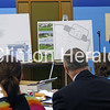 Clinton Community School Board members listen to a presentation from Andrew Reitch about plans for the new middle school during its July 9 meeting at the new administration building. • Katie Dahlstrom/Clinton Herald