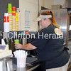 This Herald file photo shows Tasha Ross filling up a drink at Cousin's Subs/Freezer's in Fulton, Ill. - Natalie Conrad/Clinton Herald