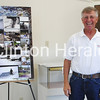 Ron Brown stands by his exhibit on commercial fishing at the Windmill Cultural Center in Fulton, Ill. on July 18. • Natalie Conrad/Clinton Herald