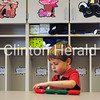 Thomas Casey plays with toys in his kindergarten classroom during Back to School Night on Wednesday at Bluff Elementary School in Clinton. The school was a flurry of excitement as 400 students and parents learned about the academic adventure they were about to begin today. • Katie Dahlstrom/ClintonHerald