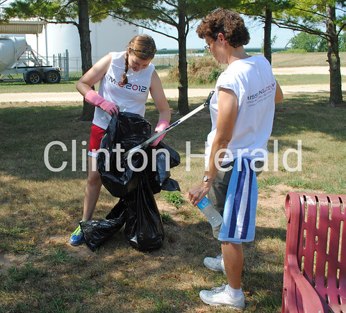 Jordan Hirl and Cindy Nelson pick up trash along the bike path in Fulton, Ill., on Wednesday as part of Evangelical Free Church's Mission Gateway program. Participants of all ages spend three weeks doing service projects in Fulton, Camanche and Clinton. • Natalie Conrad/Clinton Herald