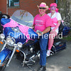 Dwayne and Sam Blaufuss showed their support for women with breast cancer along the Proud to Wear Pink Motorcycle Ride on Saturday at a stop at the de Immigrant Windmill in Fulton. • Natalie Conrad/Clinton Herald