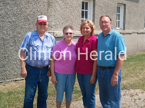 (From left) Bob Krogman, Marijo Krogman, Sandy Krogman and Marty Krogman are shown in front of the green-roofed barn at the intersection of Mill Creek Parkway and 16th Street Northwest. • Charlene Bielema/Clinton Herald