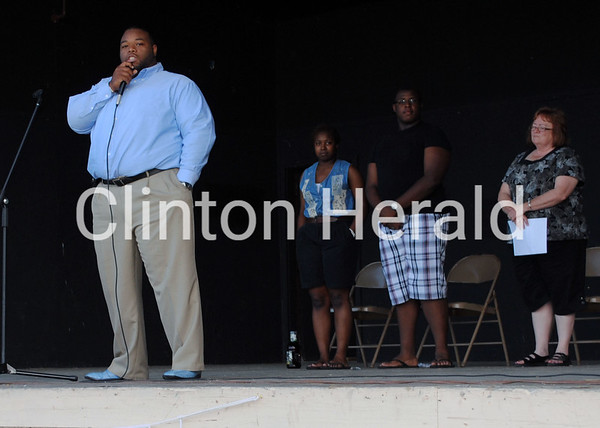Pastor Stephon Echols of Greater Praise Temple speaks at the Juneteenth celebration at Riverview Park Band Shell on June 15. • Natalie Conrad/Clinton Herald