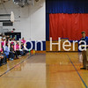 Camanche Middle School Principal Justin Shaffer speaks to an enthusiastic crowd of students about the middle school enhancement and new sign Friday during the school's pride assembly. - Katie Dahlstrom/Clinton Herald