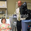 Dr. Alexander Pinc, medical director of emergency services, June 12 aids the demonstration evaluation of Mercy auxiliary volunteer Judy Ross using the new remote presence robot at Mercy North Hospital. • Katie Dahlstrom/Clinton Herald