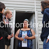 Democratic candidates Rita Hart, Dave Loebsack and Mary Wolfe talk to Clinton resident Teresa Jewell outside of her home on Sunday. - Katie Dahlstrom/Clinton Herald