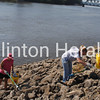 Volunteers beat the heat July 7 picking up litter and debris along Mississippi River shoreline areas during Stream Stomp. • Natalie Conrad/Clinton Herald