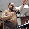 River City Municipal Band Director Ben Logan directs the band through several songs during practice on May 30 at the Ericksen Community Center. • Samantha Pidde/Clinton Herald