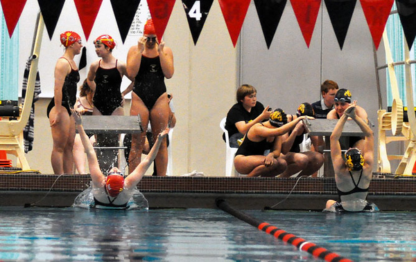 Clinton freshman Becca Hess (left) drives herself into the water ahead of Bettendorf's Lauren Ramirez to start the River Queens on their way to a third-place finish in the 200-yard medley relay Tuesday. - Jon Gremmels/Clinton Herald