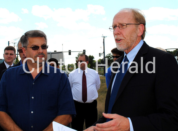Clinton Mayor Mark Vulich (left) listens to Congressman Dave Loebsack on June 22 at U.S. 30 near the intersection of Fifth Avenue South before Loebsack presented a ceremonial check for the $2.7 million TIGER grant the city received earlier this week. • Katie Dahlstrom/ClintonHerald