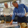 Congressman Dave Loebsack, D-Iowa, (left) looks at a map of the TMK IPSCO plant on July 16 in the company's Camanche facility with TMK IPSCO Vice President and Chief Commercial Officer Scott Barnes. • Katie Dahlstrom/Clinton Herald