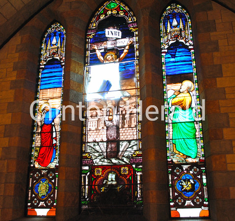 The three stained-glass windows at Clinton's St. Irenaeus Catholic Church, pictured June 18, will cost more than $14,000 to restore. The glass will be restored to better-than-new conditions, according to David Gannett of Glass Heritage, who will complete the restoration. • Katie Dahlstrom/Clinton Herald