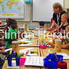 Fifth-grade teacher Carla Hilgenberg (standing right) teaches rising fourth-grade students Selena Carr, Cam'Ron Williams, John Martin, Dylan Smith, Brianna Thompson and Tanaya Wright about drums used in other cultures during summer enrichment at Jefferson Elementary School on June 20. • Katie Dahlstrom/Clinton Herald
