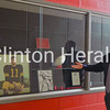 Clinton High School Activities Director Gary Lueders explains his vision for the CHS Hall of Fame on Monday. This trophy case in the entrance of the new addition at CHS could be used to display plaques and information on inductees. • Katie Dahlstrom/Clinton Herald