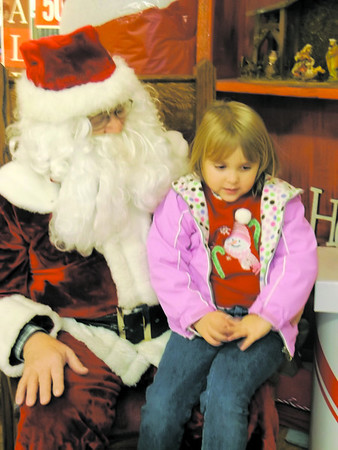 Four-year-old Maggie Sue Jenkins of Effingham tells Santa what she wants for Christmas at the Village Square Mall. Maggie is the daughter of Frank and Mindy Jenkins.