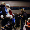 "Santa holds a Sacred Heart Grade School student at the Effingham Amtrak station. Christy Hakman, marketing and development director for Sacred Heart Grade School, said the event ties in with the school's Read Night program. December's book was ""The Polar Express"" by Chris Van Allsburg."