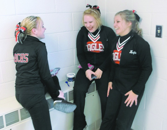 From left, Beecher City High School cheerleaders Teneale Clark, Billie Niemeyer and Kayla Krueger enjoy a laugh between games at the Dieterich Holiday Tournament.