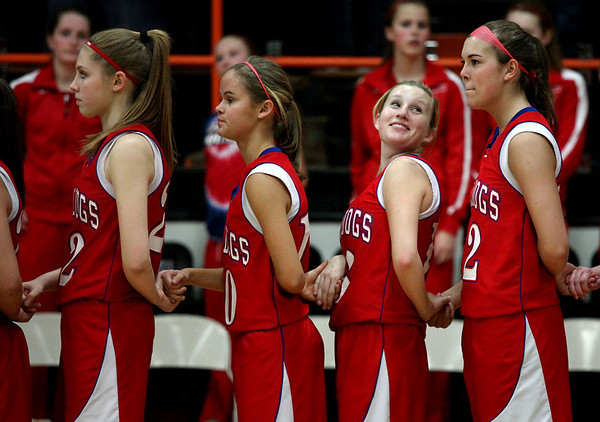 St. Anthony's Megan Schmidt grins at a teammate Monday before the playing of the national anthem at Altamont High School. St. Anthony won the game 37-17.