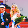 St. Anthony's Homecoming King, Charlie Schultz, escorts his Queen, Paige Willenborg,shortly after their were crowned between the junior varsity and varsity basketball games.